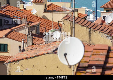 Home TV antennas mounted on a roof. - Stock Image