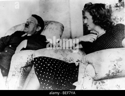 Adolf Hitler and Eva Braun relax in comfortable chairs. - Stock Image