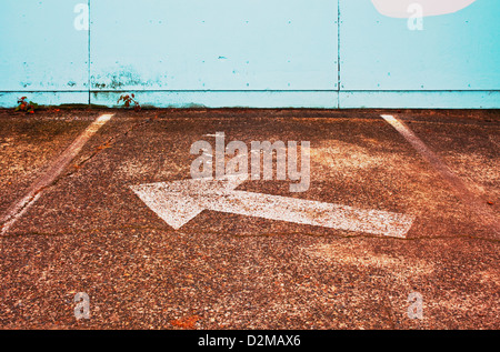 arrow sign in parking lot - Stock Image