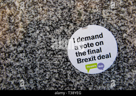 I demand a vote of the final Brexit deal - an anti brexit sticker on the pavement - Stock Image