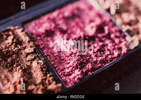 crushed blush and bronzer powders close-up shot, concept of beauty and make-up products - Stock Image