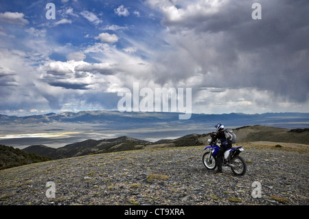 motorcycle rider in central Nevada, USA - Stock Image