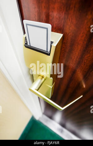 Key card in a hotel room electronic door lock - Stock Image