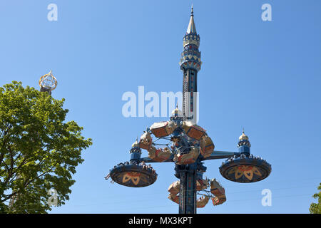 The Fatamorgana ride in the Tivoli Gardens, Copenhagen, Denmark, in early summer. Blue sky. - Stock Image