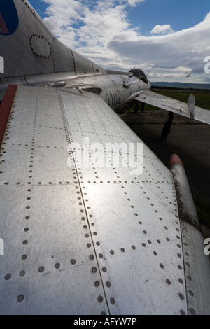 Exaggerated wide angle view of metal riveted tailplane of retired MiG-19 fighter aircraft - Stock Image