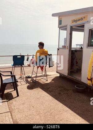 RNLI lifeguard on duty at Teignmouth beach, South devon - Stock Image