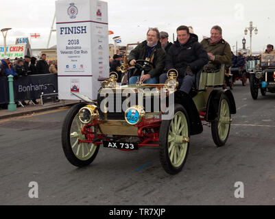 Mr Malcolm Barber driving his 1903 Peerless, across the finishing line, of the 2018 London to Brighton Veteran Car Run - Stock Image
