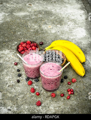 Berry smoothie in glasses. On rustic background. - Stock Image