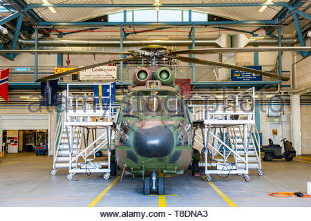 Gilze-Rijen, Netherlands. Airforce Cougar Helicopter recieving maintenance and overhaul inside the airbase's hangars. Choppers reguarty recieve mainte - Stock Image