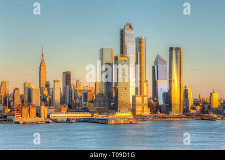 The mixed-use Hudson Yards real estate development and other buildings on the West Side of Manhattan in New York City at sunset. - Stock Image