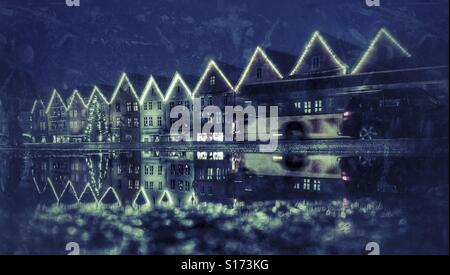 European weather; Christmas decorated and tree at the UNESCO World Heritage site, Bryggen/German warf in Bergen - Stock Image