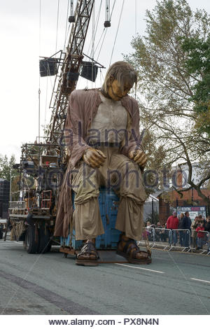 The Giant takes a rest during the Giants Spectacular parade through Liverpool city centre UK - Stock Image