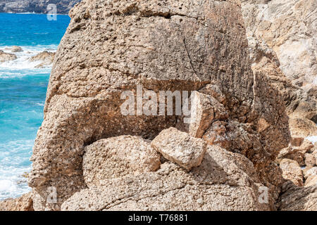 massive rock at the tidal pools in Grand Fond, St Barts - Stock Image