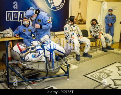 Expedition 55 Soyuz Commander Oleg Artemyev of Roscosmos prepares to have his Russian Sokol suit pressure checked in preparation for launch aboard the Soyuz MS-08 spacecraft, Wednesday, March 21, 2018 at the Baikonur Cosmodrome  Kazakhstan. Artemyev and flight engineers Drew Feustel and Ricky Arnold of NASA launched aboard the Soyuz MS-08 spacecraft at 1:44 p.m. Eastern time (11:44 p.m. Baikonur time) on March 21 to begin their journey to the International Space Station. - Stock Image