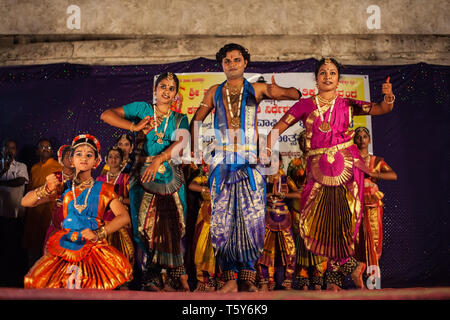HAMPI, INDIA - FEBRUARY 20, 2012: Unidentified artists performing traditional indian dance in Hampi in India at Holi festival - Stock Image