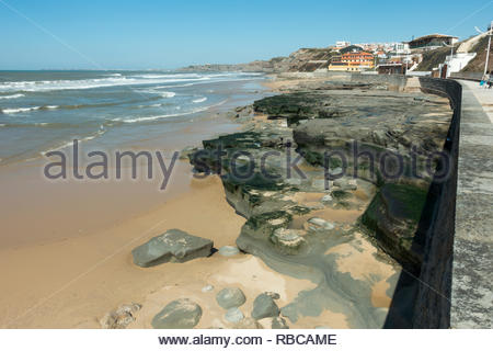 Praia da Areia Branca Portugal, images showing the exposure of rocks following high tides taking sand back out to sea - Stock Image