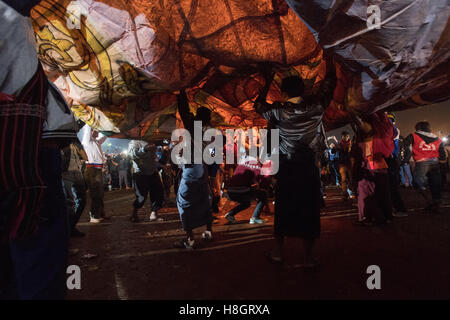 Taunggyi, Myanmar. 12 November 2016.   Balloon being inflated.  A large basket of fireworks accidentally dropped - Stock Image