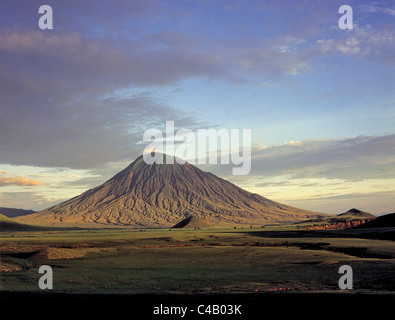 Ol doinyo Lengai, the Maasais Mountain of God, bathed in early morning sun.  It is the only active volcano in the - Stock Image