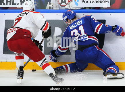 St Petersburg, Russia. 13th Sep, 2017. Avtomobilist Yekaterinburg's Nikolai Timashov (L) and SKA St Petersburg's Mikhail Maltsev fight for the puck in their 2017/18 KHL Regular Season ice hockey match at St Petersburg's Ice Palace. SKA St Petersburg won the game 6-2. Credit: Alexander Demianchuk/TASS/Alamy Live News - Stock Image