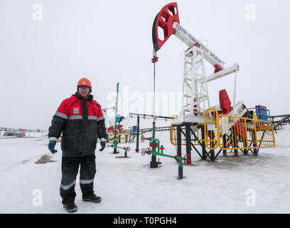 KOGALYM, RUSSIA – MARCH 21, 2019: A worker at the Yuzhno-Yagunskoye oil field developed by Kogalymneftegaz, a subsidiary of the Lukoil-West Siberia oil and gas company. Vyacheslav Prokofyev/TASS - Stock Image