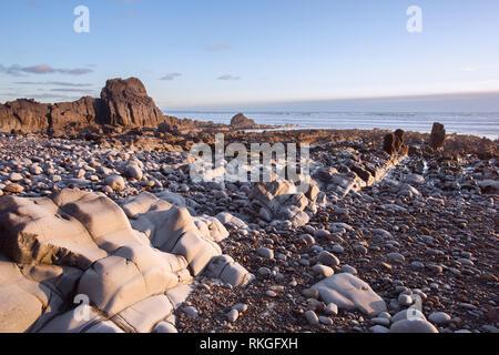 Sunset Sandymouth beach Cornwall uk - Stock Image