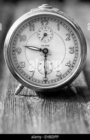 Black and White Photograph of a Vintage Alarm Clock - Stock Image