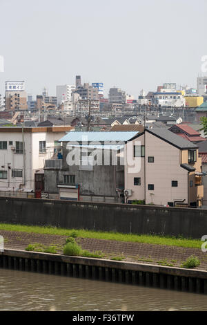 suburbia riverside riverbed city in distance - Stock Image