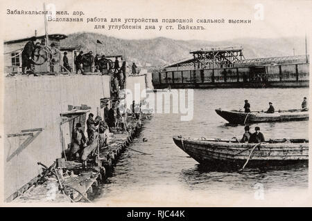 The Trans-Baikal Railway - a subsidiary of the Russian Railways headquartered in Chita and serving Zabaykalsky Krai and Amur Oblast. The mainline was built between 1895 and 1905 as part of the Trans-Siberian Railway. Here, divers are being used to survey the riverbed prior to the construction of a railway bridge. Hazards faced for the tens of thousands of workers employed in the construction of the railway included the complex terrain, crossed by ridges, rivers and swamps, permafrost, low winter temperatures, and natural disasters. - Stock Image
