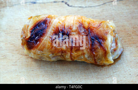 Home made food. Roasted  sarmi. Traditional meals with rice-stuffed cabbage leaves for Christmas Eve. - Stock Image