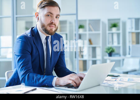 Busy young broker - Stock Image
