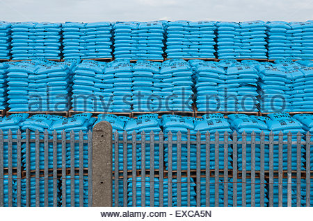 |Stacks of blue plastic sacks containing and labelled rock salt - Stock Image