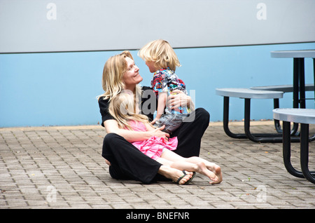 Happy mother hugging her daughter and son in Texas, USA - Stock Image