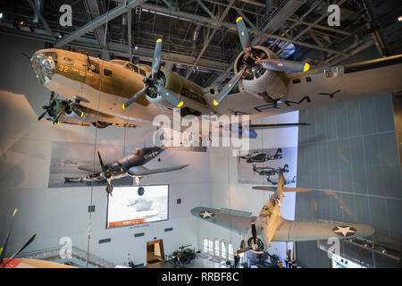 View of WWII warplanes displayed inside the National World War Two Museum in the Warehouse District of New Orleans, Louisiana, USA. - Stock Image