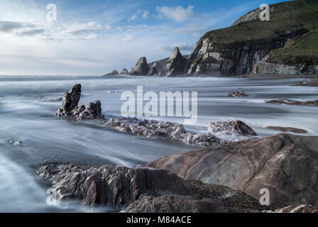 Waves rush over the beach at Westcombe Bay in the South Hams, Devon, England. Winter (January) 2018. - Stock Image
