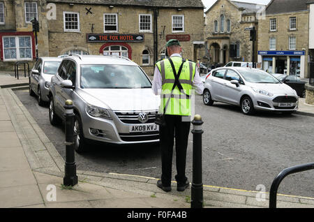 Parking warden in Chipping Norton in The Cotswolds. - Stock Image