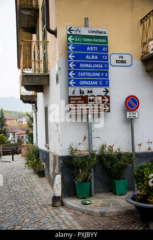 Street view with sign posts in the small town of Barolo in Italy's Piedmont - Stock Image