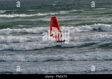 East Wittering, UK. 19th September 2018. Windsurfer(s) brave wild, wet and windy weather  of Storm Ail - our first named storm of the season. Weather was  recorded at the Chichester Bar at 3pm BST  a mean speed of 29 Knots highest gusting  35 .4 Knots The Met Office have issued an yellow weather warning for this area with strong winds and heavy rainfall.Credit Gary Blake / Alamy Live News - Stock Image