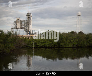 The SpaceX Falcon 9 rocket, with the Dragon spacecraft onboard, is seen at Launch Complex 39A at NASA's Kennedy - Stock Image