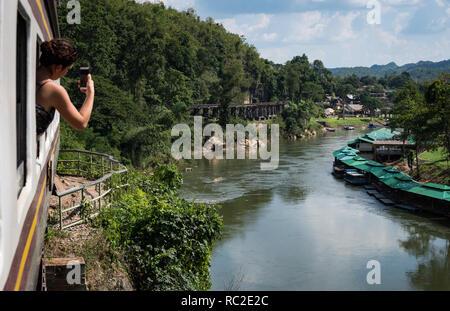 Kanchanaburi, Thailand - Nov 2018: The Death Railway running along the River Kwai - Stock Image