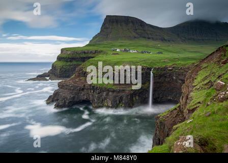 Waterfall cascading over cliffs at Gasadalur in the Faroe Islands, Denmark. Summer (June) 2017. - Stock Image