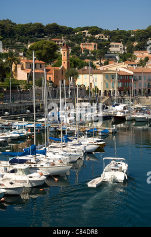 St. Jean Cap Ferrat, harbour with church in background, motor boat - Stock Image
