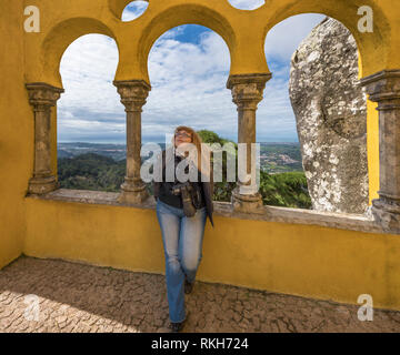 Girl-photographer at Sintra palace walls. Portugal - Stock Image