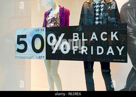 Black Friday signs on shop store window England UK United Kingdom GB Great Britain - Stock Image