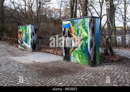 Berlin- Zehlendorf. Krumme Lanke. Decorative paitwork on Utility Box - red squirrel  in tree painting - Stock Image
