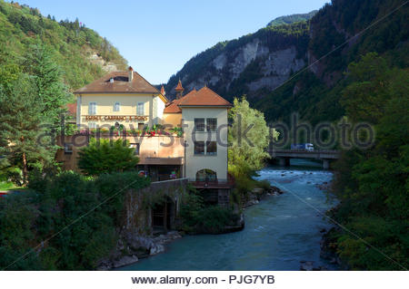 Espace Carpano & Pons, - former watch making factory, now museum & tourist office, by the Arve river in Cluses in Auvergne-Rhône-Alpes region, France. - Stock Image