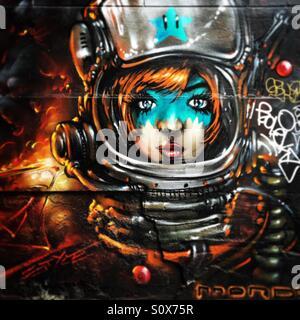 Street art of an astronaut girl in Melbourne Australia - Stock Image