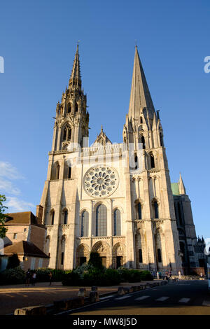 The two contrasting spires at the west facade of Chartres Cathedral France - Stock Image