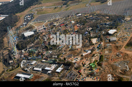 Amusement park with water slides and rollercoasters seen from above - Stock Image