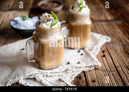 Delicious cold drink – iced coffee with ice and cream - Stock Image