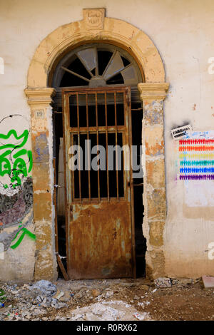 Old doorway with graffiti, North Nicosia, Turkish Northern Cyprus October 2018 - Stock Image